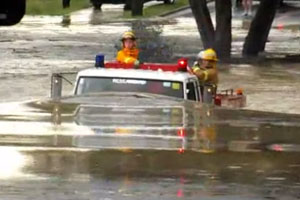 Fire Truck Plows Through Flood Waters