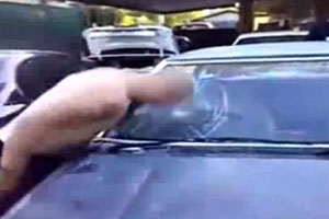 Smashing Cars Windshield With a Head