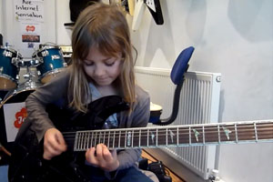 8-Year-Old Plays A Guitar