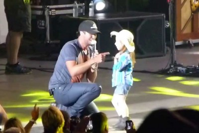 Luke Bryan Takes A Little Girl On Stage