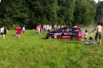 Rally Car Nearly Misses Spectators