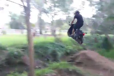 Jumping Over A Ditch With A Scooter