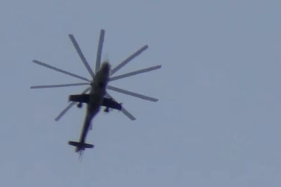Barrel Bomb Falls Meters Away From Man Who Is Filming