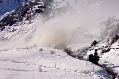 Huge Avalanche Flows Down River Bed In Italy