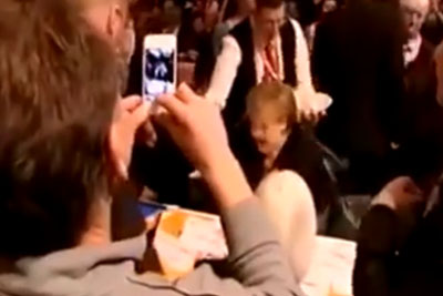 A Waiter Accidentally Spills Glasses Of Drink On Merkel's Back