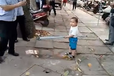 Toddler Picked Up Steel Pipe To Defend His Grandma From China's Management Force
