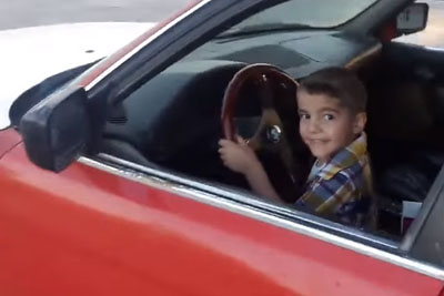 3 Year-Old Boy From Iraq Doing Donuts In A BMW