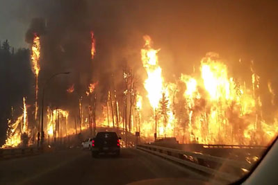 Dramatic Footage Of Evacuating Fort McMurray Due To Massive Fire