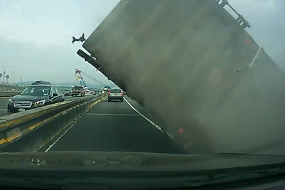 Lucky Driver Escapes Tractor Truck Accident