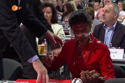 German MP Suffers Cake Attack Over Refugee Stance
