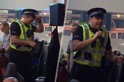 World's Chillest Cop Sings 'I Will Survive' At Gay Bar After Being Called For Disturbance