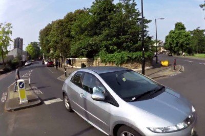 Car Driver Speeds In To Roundabout And Almost Hits Cyclist