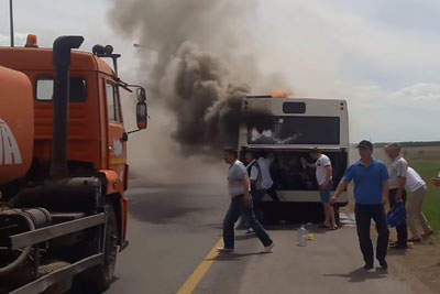 Bus In Kazakhstan Set On Fire, But A Water Hauler Is There To Take Fire Dept Duty