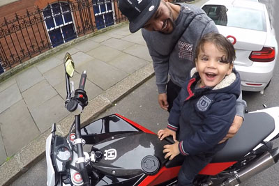 Biker Makes Kid's Day By Letting Him Sit On His Bike