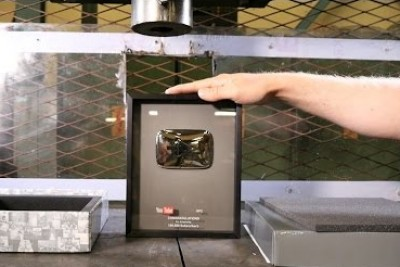 Man Crushes YouTube Silver Play Button In His Hydraulic Press