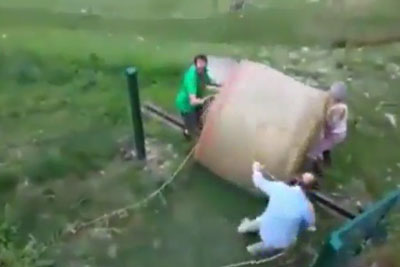 Farmers Lose Bale Of Hay In Spectacular Fashion