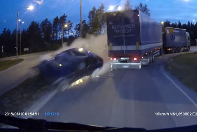 Car Goes Flying Across Roundabout, Near Missing Two Trucks