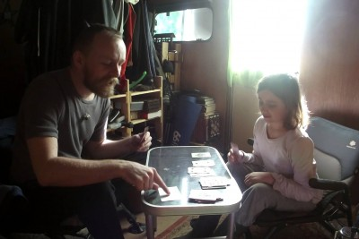 A Father With Tourette's Syndrome Playing A Game Of Cards With His Daughter