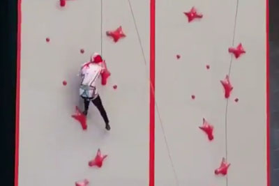 Woman Absolutely Destroys Indoor Rock Climbing Speed Course