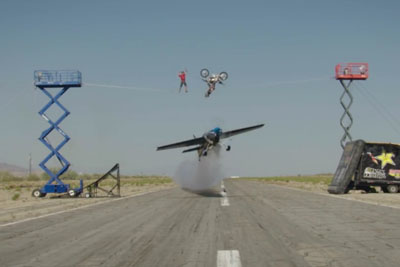 World First Trick With Aerobatic Pilot Flying Under Highliner And Freestyle Motocross Driver