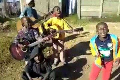 Little Rural South African Kids Tearing It Up On The Guitar