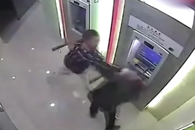 Chinese Man Beats Up Robber While Completing ATM Transaction