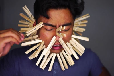 Can Thiy Guy Place 100 Layers Of Clothes Pins On His Face?