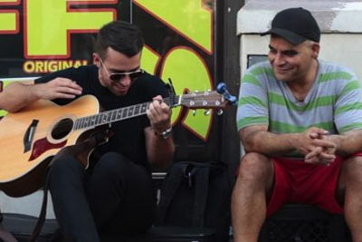 This Man Performs Next To Homeless People So They Get More Cash