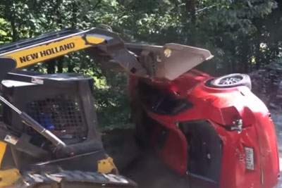 Dad Punishes His Daughter By Smashing Up Her Audi With A Digger