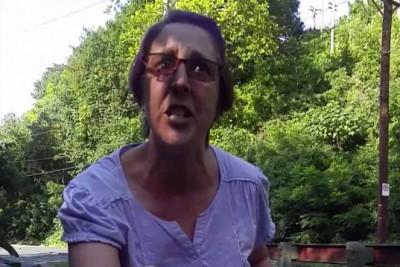 Insane Woman Attacks Bratty Man-Child Riding His Moped On Bike Path