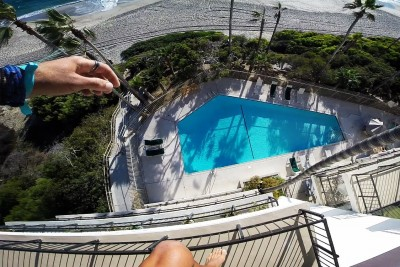 Dude Sneaks Into A Hotel Just To Jump Off A Balcony Into A Pool