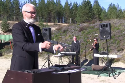 Band Plays 'Ode To Joy' And Other Songs While This Guy Uses Guns