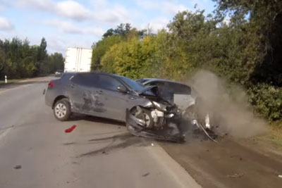 Reckless Driver Crashes Hard Into Standing Vehicles