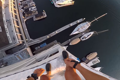 Guy Jumps Off 129-Foot Building Into Harbor, Misses Dock By Inches