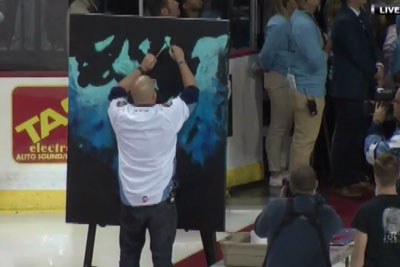 Man Sings US National Anthem At Hockey Game While Painting A Picture