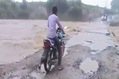 Flooding River Flushes Away Enced Motorcyclist