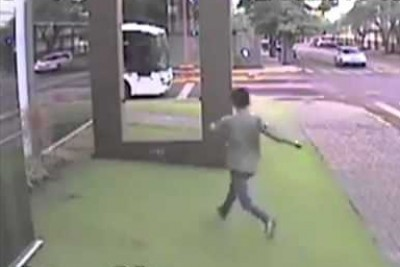 Kid Smashes Through Glass Wall Trying To Catch The Bus