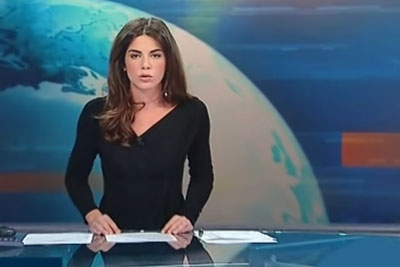 Italian Female News Reporter Forgets We Can See Everything Through Glass Desk