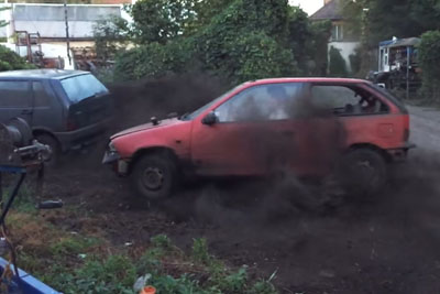 Just Two Guys Expertly Drifting Two Old Hatchbacks In A Junkyard