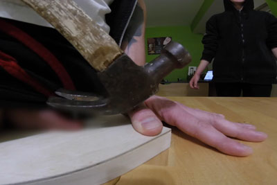 Crazy Guy Nails His Balls To The Wooden Desk