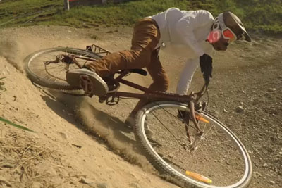 Professional Downhill Rider Rides A Course With An Old City Bicycle