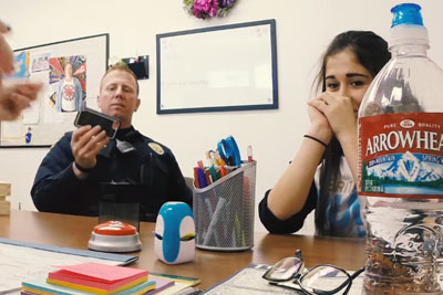 Student Cries As Principal Hands Cop Her Phone. He Quickly Realizes Something Is Off