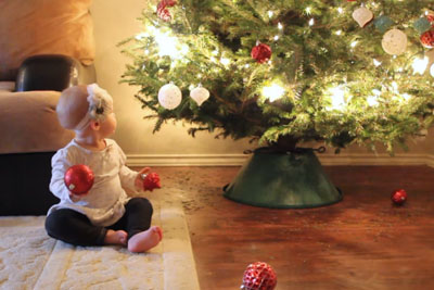It's Baby's First Christmas - Her Antics Have Everyone In Laughter