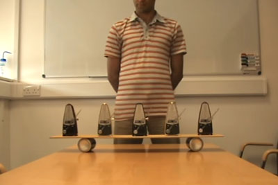Guy In Video Shows Us How A Synchronisation Of Five Metronomes Looks Like