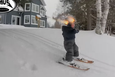 2-Year-Old Boy Enjoys His Day While Skiing His First Snow Powder