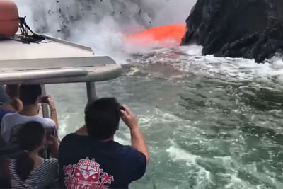 Molten Lava Shoots Into The Ocean In Front Of Tourist Boat On Hawaii