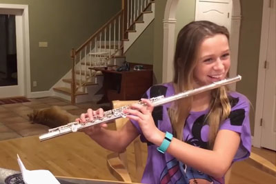 Young Girl's Trying To Practice Flute, Instead Dog Has Internet In Laughter