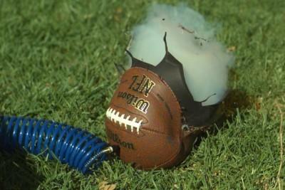 Over-Inflating Footballs Captured In Super Slow Motion