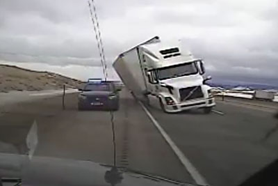 High Winds Tip Semi Truck On Interstate 80 Directly Onto A Cop Car