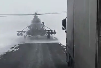 Military Helicopter Lands On A Road In Kazakhstan To Ask Trucker For Directions